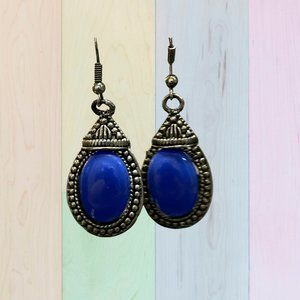 Earrings with a blue stone